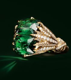 Ring in 18k gold with a pair of oval green tourmalines totaling over 28 carats.