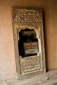 Inspired by elaborate Indian doorways, this ornate wood mirror features intricate floral motifs hand-carved into reclaimed wood. Stunning in a bedroom, bathroom, or hallway, it lends a hint of elegant