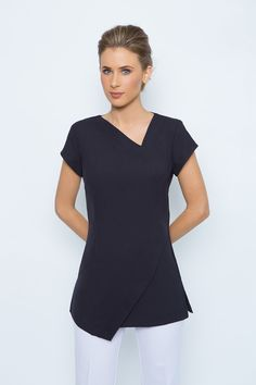 has a beautiful shape & suits all body shapes. Abstract neck and hem line to elongate the body. Cap sleeves with side splits for easy movement, zips at the rear. Spa Uniform, Uniform Ideas, Beauty Tunics, Salon Wear, Beauty Uniforms, Tunic Designs, Work Uniforms, Work Tops, Scrub Tops