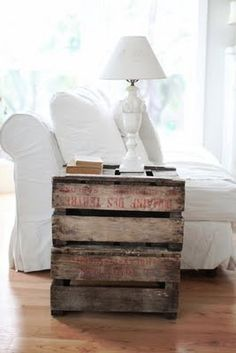 old crate as side table also for throw storage in the living room