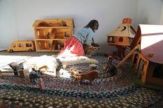 Homemade rug. Wooden toys. Calm