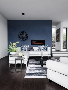 Take your living room to new levels of chic that you can easily do yourself. Dark bamboo flooring clicks into place, and anyone can coat a wall with a deep denim blue. Your floor and wall let you match that rich club chair with a white leather sectional. Blue And White Living Room, Accent Walls In Living Room, Classic Living Room, Paint Colors For Living Room, Living Room Grey, Living Room Kitchen, Dark Floor Living Room, Livingroom Paint Ideas, Dark Blue Couch
