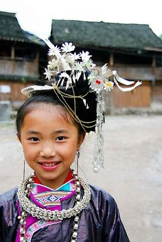 China | Maio minority girl in festivity dress | ©TOM shot ~ freelife, via flickr