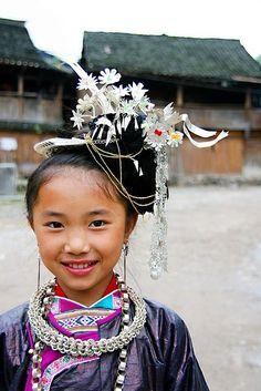 China | Maio minority girl in festivity dress | ©TOM shot ~ freelife, via flickr