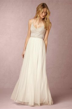 Oh my! 19 totally Exquisitely Romantic Bohemian Wedding Dresses! Naya Bohemian Bridal Gown: Feminine and oh-so chic, sequins and beads encrust the delicate, spaghetti-strap bodice of this stunning dress designed by Adrianna Papell , while an airy tulle skirt provides movement; a sultry v-back completes the boho bridal look.