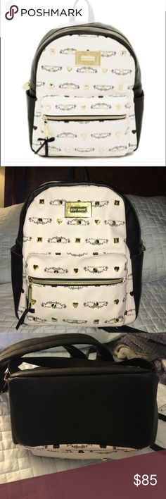 Betsey Johnson backpack. Deux Lux Playa style. Betsey Johnson Deux Lux Playa backpack. Black and white with gold hardware and studs. Extra strap included. Perfect condition NWOT. HTF in this color and style. Measurements: Height: 13in / 33cm Length: 11.75in / 30cm Depth: 4.25in / 11cm Betsey Johnson Bags Backpacks