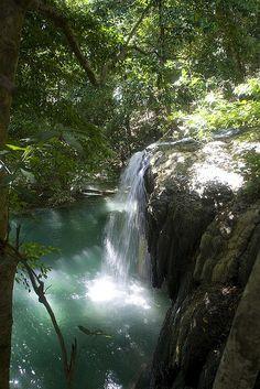 Tropical waterfall in Moyo Island, Indonesia (by John Mason).