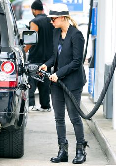 Kaley Cuoco rocks a cute outfit as she pumps gas in Los Angeles.