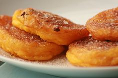 "The South African pumpkin fritters also known as ""Pampoenkoekies"" Recipe Desserts with pumpkin, salt, flour, baking powder, eggs, milk, sunflower oil, butter, lemon wedge, sugar, cinnamon"