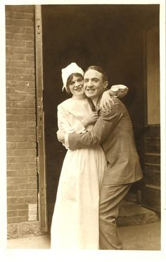 A nurse and her boyfriend embrace for a portrait, ca. 1918. Pictures of Nursing: The Zwerdling Postcard Collection. National Library of Medicine