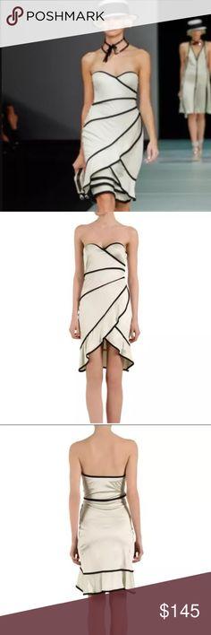 Emporio Armani New dress Beautiful Emporio Armani dress. Retail price: $590 Silky material with push-up bra.💋👗 size 38 Emporio Armani Dresses Midi