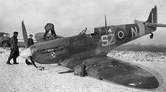 316 Sqdn Spitfires 1943. Mk I converted to M V. Bare metal on wing