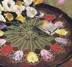 INSTANT DOWNLOAD VINTAGE CROCHET PATTERN PDF    Think spring with this one-of-a-kind Tulip Doily from 1950! The center of the doily is so lovely