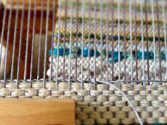 Twining at the end of a rag rug on the loom.
