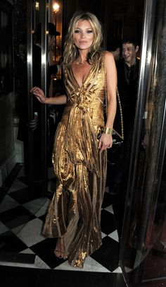 Kate Moss in a gold Marc Jacobs gown at her book launch after-party
