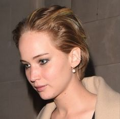 Jennifer Lawrence takes London town in EF Collection Rose Gold diamond disc lever back earrings.