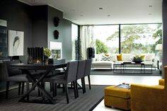Dark accent wall with black dining room table & chairs: Slettvoll