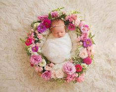 baby ringed with flowers  Newborn photos image by jennifer kaye photography flowers and baby by kio kreations