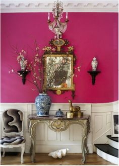 Pink walls with brass accents - a little girly but definitely a twist on modern.