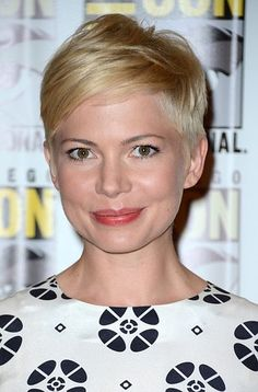 Michelle Williams wears a coral lip color and nothing more.