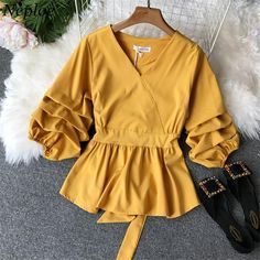Gender: WomenSleeve Style: Puff SleeveFabric Type: BroadclothBrand Name: NeploeSleeve Length(cm): FullMaterial: Polyester,Cotton,AcrylicCollar: V-NeckDecoration: NoneClothing Length: RegularPattern Type: SolidModel Number: 68860Style: Casual