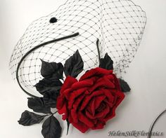 This amazing couture fascinator with veil and Red Rose is made from natural velvet and silk fabrics using special milinery hot tools. Each