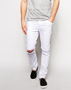"""Skinny jeans by ASOS Made from stretch denim Stretch is added for comfort and fit Reinforced seams for added strength Quality cotton twill pocket bags Hanger loop to centre back Ripped details to knees Five pocket styling Button fly Skinny fit - cut closely to the body Machine wash 98% Cotton, 2% Elastane Our model wears a 32""""/81 cm regular and is 188cm/6'2"""" tall"""