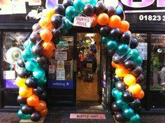 Halloween style balloon arch with cobweb