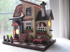 Decorative Wooden Coffee shop Birdhouse Night light or accent light. $19.99, via Etsy.