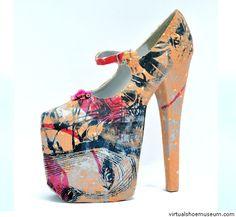Graffiti face, Ivanka Ska. Triple platform high heel shoes made out of vintage materials.