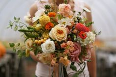 lush organic pink, orange, yellow and white fall bouquet with roses, zinnias and daisies   floral design: Floret Flowers