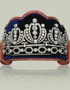 AN ANTIQUE DIAMOND TIARA c1860-1880. Composed of five graduated palmette elements, above a line with trefoil motifs and an openwork link base, set throughout with old-cut diamonds, all elements detachable, mounted in silver and gold. Christie's.