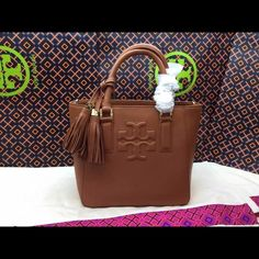 "Tory Burch Thea mini bucket bag #bark Drop in zipper pocket. Interior zipper pocket and two open pockets. Tubular leather handles with (11 cm) drop. Removable leather and chain strap with 19"" (50 cm) drop. protective metal feet. H8"" (21 cm) L8.5""  (21.5 cm) D6"" (15 cm)  A true dress-up or dress-down style. Made of pebbled Italian leather. It's a chic, versatile choice for day or evening. NWT & AUTHENTIC 100%. Comes with dust bag and original packaging. Retail $395. Only accept reasonable…"