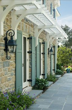 Door  Window #Shutters---Love the lanterns, shutters, and the stone on the home!