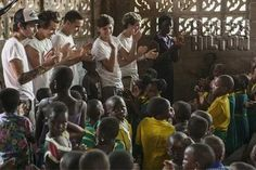 Harry Styles Tweets Pic Of One Direction's Ghana Visit! So Cute! -                                 Aw, look at the boys!  Being all inspirational and stuff!  One Direction had such a wonderful time in Ghana for the UK's Red Nose Day/Comic Relief effo