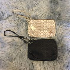 Two small Coach wristlets Gold Coach wristlet and Black Coach wristlet. Gold one has a small spot on it. I have not tried to clean. Perfect for your cash/cards and lipgloss! Coach Bags Clutches & Wristlets