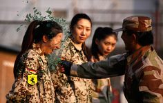 """Wow! """"An instructor from the Tianjiao Special Guard/Security Consultant Ltd. Co, smashes a bottle over a female recruit's head during a training session for China's first female bodyguards in Beijing,"""" 2012 Year in Pictures: Part I - The Big Picture - Boston.com"""