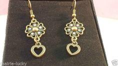 Pendientes-vintage-bronce-flor-cinco-petalos-con-pequenos-cristales-blancos