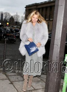 Kate Moss spotted out and about wearing a fabulous Prada fur and gorgeous Prada blue leather clutch in Paris on January 25, 2012.    *courtesy of Delortae Agency UK's exclusive luxury authentic handbag SPA Visit us on Facebook: www.facebook.com/DelortaeAgency