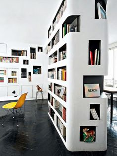 Built in modern bookshelf with curved edges