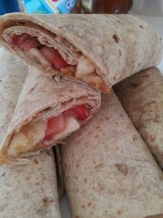 Whole wheat wraps, peanut butter, strawberry, banana & honey ...great for breakfast, quick after school snack, or anytime you want a yummy healthy quick snack!!