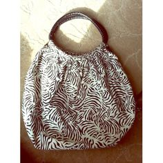 Big zebra bag Very spacious. Makes a nice beach bag. A little wear and tear. In great condition just a little dirty. About 18 x 24 inches including straps. Sorpresa! Bags