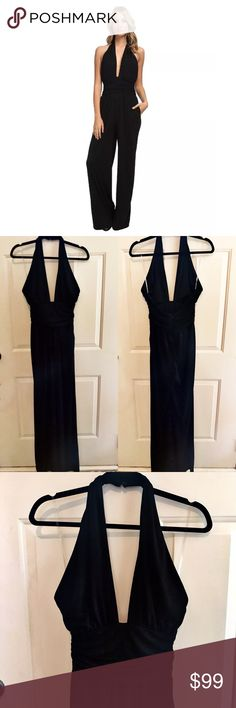 """Sam Edelman Black Halter Jumpsuit Romper New with Tags. Sam Edelman Black Halter Jumpsuit with Draped Deep Plunge Neckline. Features ruched empire waist, open back, hidden hand pockets. The button closure on the halter. Hidden back zipper closure on the body of the jumpsuit. Gorgeous draped silhouette. This Jumpsuit will set you apart from the crowd. Stunning! Please see Sam Edelman size chart in the last picture. Approximate inseam 33"""". 👗👛👠👙👕Bundle & Save! Sam Edelman Pants Jumpsuits…"""