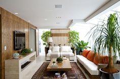 Acerte na decoração da sala de TV. Inspire-se em 12 espaços criados por arquitetos