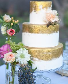glittery gold metallic pairs with feminine floral for an effortless and romantic wedding cake