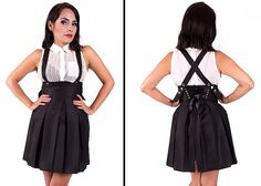 Give a elegant touch to your look with this Suspender Skater Skirt with corset closure at back. Take your office-ready outfit and spice it up a bit for a night out on the town with these suspender skirt. You can choose to wear it between a patterned top or a solid colored one to go with the skirt.