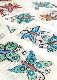 Book pages, draw butterflies with ultra fine point Sharpie, then paint with watercolor.