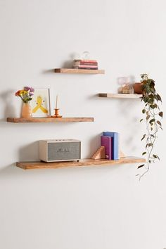 Shop Simple Floating Wood Wall Shelf at Urban Outfitters today. Floating Shelves Bedroom, Floating Bookshelves, Wood Floating Shelves, Bedroom Wall Shelves, Floating Shelf Decor, Hanging Bookshelves, Decorating With Floating Shelves, Floating Nightstand, How To Make Floating Shelves