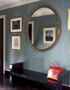 Albert Hadley: A scalloped wood-and-gesso mirror above a lacquered bench in the foyer shows the reflection of a photograph taken in Peru by the American photographer Louise Dahl-Wolfe, famous for her Harper's Bazaar fashion work. Design Entrée, House Design, Interior Design, Old Fashioned Christmas Decorations, Albert Hadley, Foyer Furniture, Large Round Mirror, Foyer Decorating, Decorating Ideas