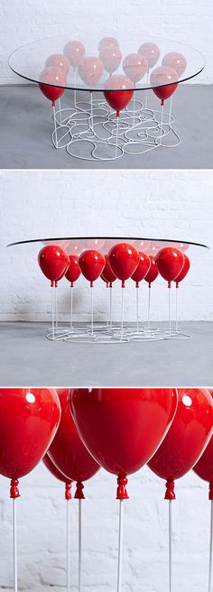 Colorful balloons appear to lift a glass tabletop into the air in the playful UP Balloon Table created by Duffy London. The balloons are made of metal resin composite while the strings are strengthened steel. The table can be ordered with red, gold, or silver balloons.